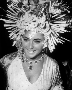 Elizabeth Taylor wears Bulgari jewellery at the masked ball, Hotel Ca'Rezzonico, Venice  (1967)