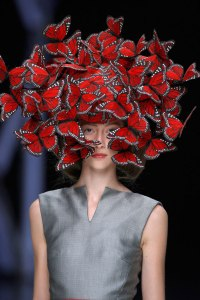 Butterfly headdress of hand-painted turkey feathers Philip Treacy for Alexander McQueen La_Dame Bleu Spring Summer, 2008 © Anthea Sims, the V&A Museum, London.
