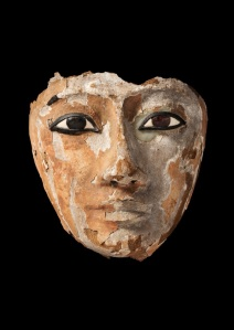 Wooden face with inlaid eyes, originally part of a coffin, Third Intermediate Period, Dynasty 22 (945 - 715 BC). Possibly from excavations atAbydos. Courtesy Two Temple Place and Baghshaw Museum (Kirklees Council) A © Two Temple Palace, London.