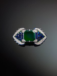 Brooch set with emeralds, sapphires and diamonds by Cartier, Paris, France, 1922, credit The Al Thani Collection © Servette Overseas Limited, 2014, ph. Prudence Cuming Associates Ltd.