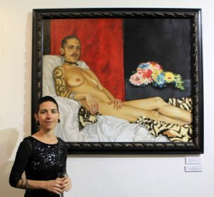Rosso with her painting Madame Moustache, Winner of the 2016 Emerald Winter Pride Art Awards, © photo by Tania Olive, co. Islington Arts Factory, London.
